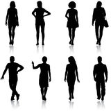 Black silhouette group of people standing in various poses.  stock illustration