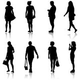 Black silhouette group of people standing in various poses Stock Photos