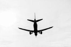 Black silhouette of a landing plane Stock Photography