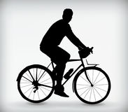 Black silhouette of a man on a bicycle vector illustration Stock Photos