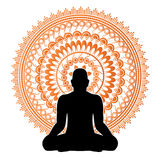 Black silhouette of man in meditation pose. Stock Photos