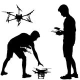 Black silhouette of a man operates unmanned quadcopter vector illustration Royalty Free Stock Image