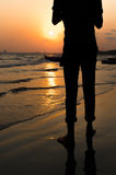 A black silhouette of a man standing  at the sunrise Stock Images