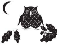 Black silhouette of an owl. Stock Photos
