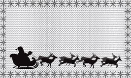 Black silhouette of Santa Claus flying in a sleigh on white    Royalty Free Stock Photography