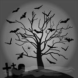 Black silhouette of a spooky tree with bats, gravestones, spiderwebs  Royalty Free Stock Photography