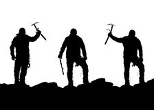 Black silhouette of three climbers with ice axe in hand. On the white background Royalty Free Stock Photography