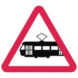 Black silhouette of tram at red triangle frame, vector icon, traffic sign Stock Image