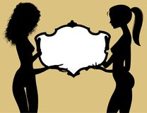 Black silhouette of two fine naked girls holding a vintage frame Stock Images