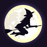 Black silhouette of witch flying on broomstick with moon. Beautiful shining moon in dark blue sky and silhouette of young witch flying on broomstick. Background Stock Photo