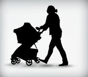 Black silhouette of a woman with baby carriage vector illustration Stock Image