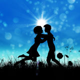 Couple silhouette on grass field Stock Photography