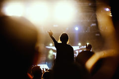 Black silhouette of young girl on rock concert Stock Photo