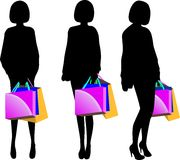 Black silhouette of young woman with shopping bags. Isolated on white Royalty Free Stock Photos