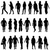 Black silhouettes of beautiful mans and womans on white backgrou Royalty Free Stock Photos