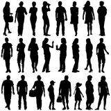 Black silhouettes of beautiful mans and womans on white backgrou Royalty Free Stock Photo
