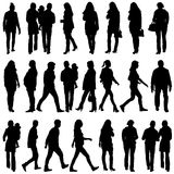Black silhouettes of beautiful mans and womans on white backgrou Stock Photography