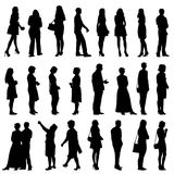Black silhouettes of beautiful mans and womans on Royalty Free Stock Photo