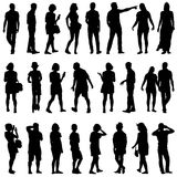Black silhouettes of beautiful mans and womans Stock Images