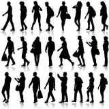Black silhouettes of beautiful mans and womans on Royalty Free Stock Image