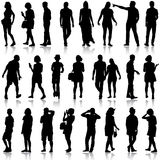 Black silhouettes of beautiful mans and womans on Stock Photography