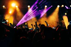Crowd at a concert with hands up stock image
