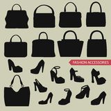 Black silhouettes of  fashion women's handbag,high-heeled shoes Stock Image
