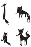 Black silhouettes of four foxes Stock Photos