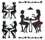 Black silhouettes of girls in cafe. Black isolated   silhouettes of girls in cafe Royalty Free Stock Image