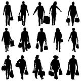 Black silhouettes man and woman with bags packages Stock Images