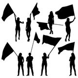 Black silhouettes of  mans and womans with flags Stock Photography