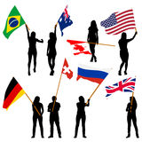 Black silhouettes of  mans and womans with flags Royalty Free Stock Image