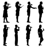 Black silhouettes of mans and womans singing Stock Photo