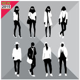 Black silhouettes of men and women,autumn,fall,summer attire,outfit,totally ,set,collection. Black silhouettes of men and women with white cloths on top,autumn Royalty Free Stock Images