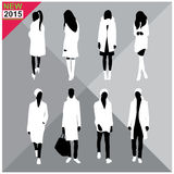 Black silhouettes of men and women,autumn,fall,summer attire,outfit,totally ,set,collection. Black silhouettes of men and women with white cloths on top,autumn Royalty Free Stock Image