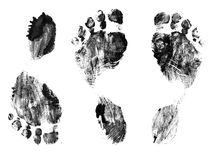 Black silhouettes of prints a foot Royalty Free Stock Photo