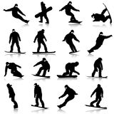 Black silhouettes set snowboarders on white Royalty Free Stock Photography
