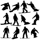 Black silhouettes set snowboarders on white Stock Photos