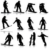 Black silhouettes set snowboarders on white Stock Photo