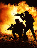 Black silhouettes of soldiers royalty free stock image