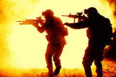 Black silhouettes of soldiers Royalty Free Stock Images