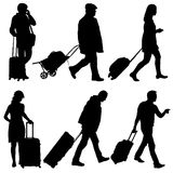 Black silhouettes travelers with suitcases on white background. Stock Photos