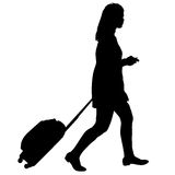 Black silhouettes travelers with suitcases on white background. Stock Photo