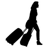 Black silhouettes travelers with suitcases on white background. Royalty Free Stock Image