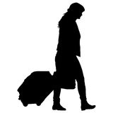Black silhouettes travelers with suitcases on white background. Royalty Free Stock Photo