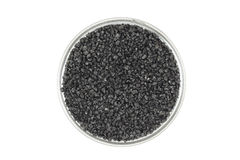Black silicon carbide powder in a glass container Stock Images