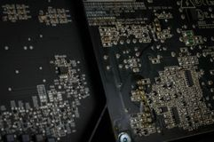 Silicon Computer Motherboard with Solder and Circuits. Black silicon high performance technology computer motherboard with solder, brackets, and circuits stock photos