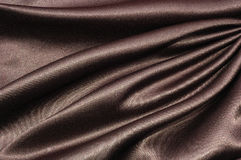 Black silk. Silk background, material pattern , close up Stock Photos