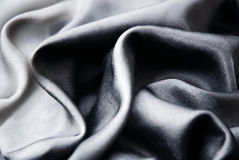 Black silk. Shiny black silk as background stock images