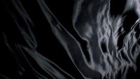 Black silk cloth moving stock video